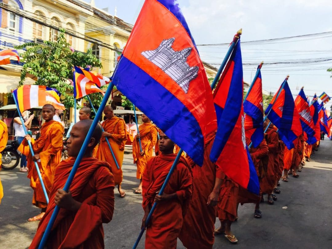 Monks walking in the parade for Meak Bochea Festival - Living and Working in Siem Reap - Four Month Update