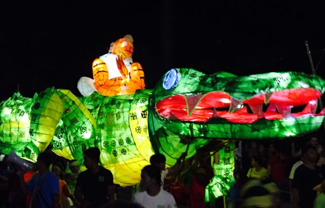giant puppet parade Siem Reap Cambodia Crocodile puppet lit up at night