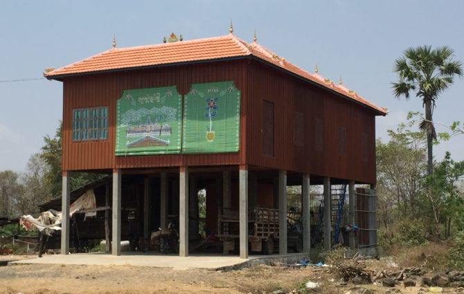 House with colourful, painted wooden blinds, Cheung Kok Ecotourism Village, Cambodia