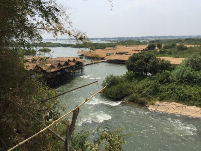 Kampi Rapids near Kratie in Cambodia. Platforms above rapids and people swimming