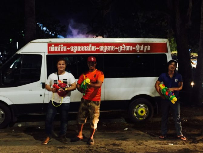 Men with water guns on Khmer New Year in Siem Reap, Cambodia