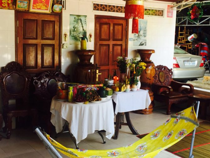 Khmer New Year offering, Siem Reap, Cambodia. Table of fruit, vegetables, incense and drinks