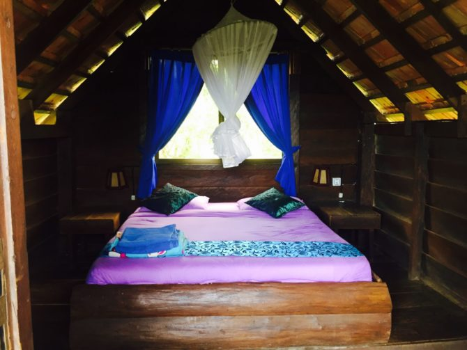 Inside of Bungalow at Nature Lodge in Mondulkiri. Double bed and mosquito net