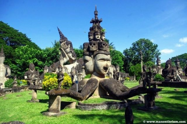 Four headed Buddha statue in Buddha Park in Vientiane, Laos