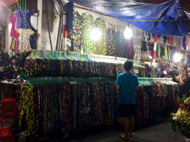 Brightly coloured, tropical fruit print clothes in Hanoi, Vietnam