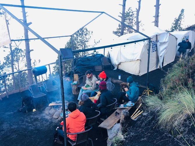 Balam Tours Acatenango Base Camp - hikers around the campfire near tents