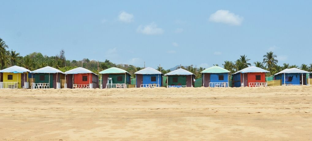 Best South Goa beaches. A row of colourful beach huts on Agonda Beach