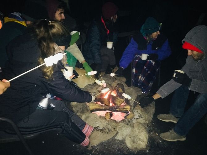 Dinner and marshmallows round the campfire with Balam Tours Acatenango