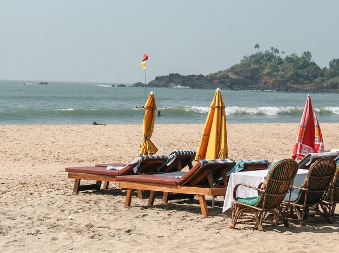 Patnem Beach in South Goa. Sunbeds and parasols on the beach.