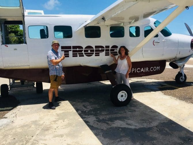 Tropic Air Belize Plane with Tanya and Andy standing in front of it.